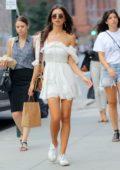 Emily Ratajkowski wears a white mini dress while out shopping in New York City