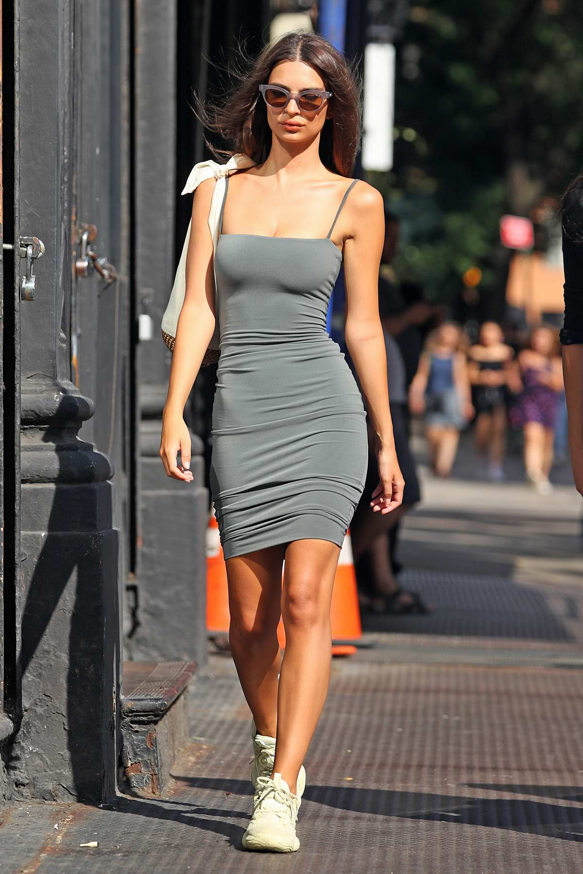 Emily Ratajkowski wears grey form-fitting dress with white sneakers while out in New York City