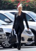 Gwen Stefani wears an all black ensemble with high heels while attending Mass Service with her kids at St. Brendan Catholic Church in Los Angeles