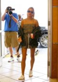 Hailey Baldwin steps out in a strapless minidress for lunch in Beverly Hills, Los Angeles