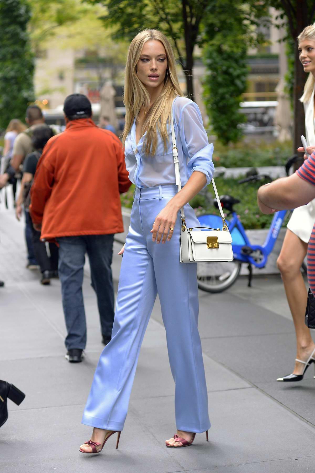 hannah ferguson rocks a blue sheer top and blue pants while