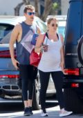 Hilary Duff enjoys a smoothie as she leaves her yoga class with boyfriend Matthew Koma in Studio City, Los Angeles