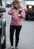 Hilary Duff seen wearing a pink sweatshirt and Fendi flip flops as she grabs a breakfast smoothie in Los Angeles