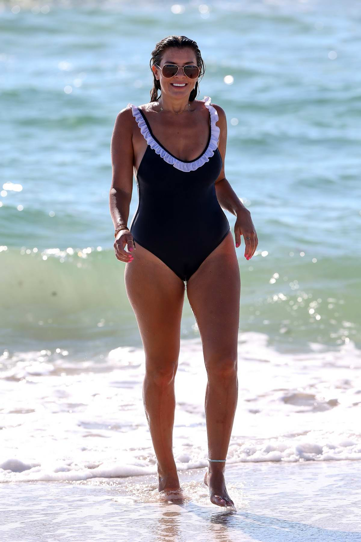 Imogen Thomas goes for a swim in a blue swimsuit in Miami, Florida