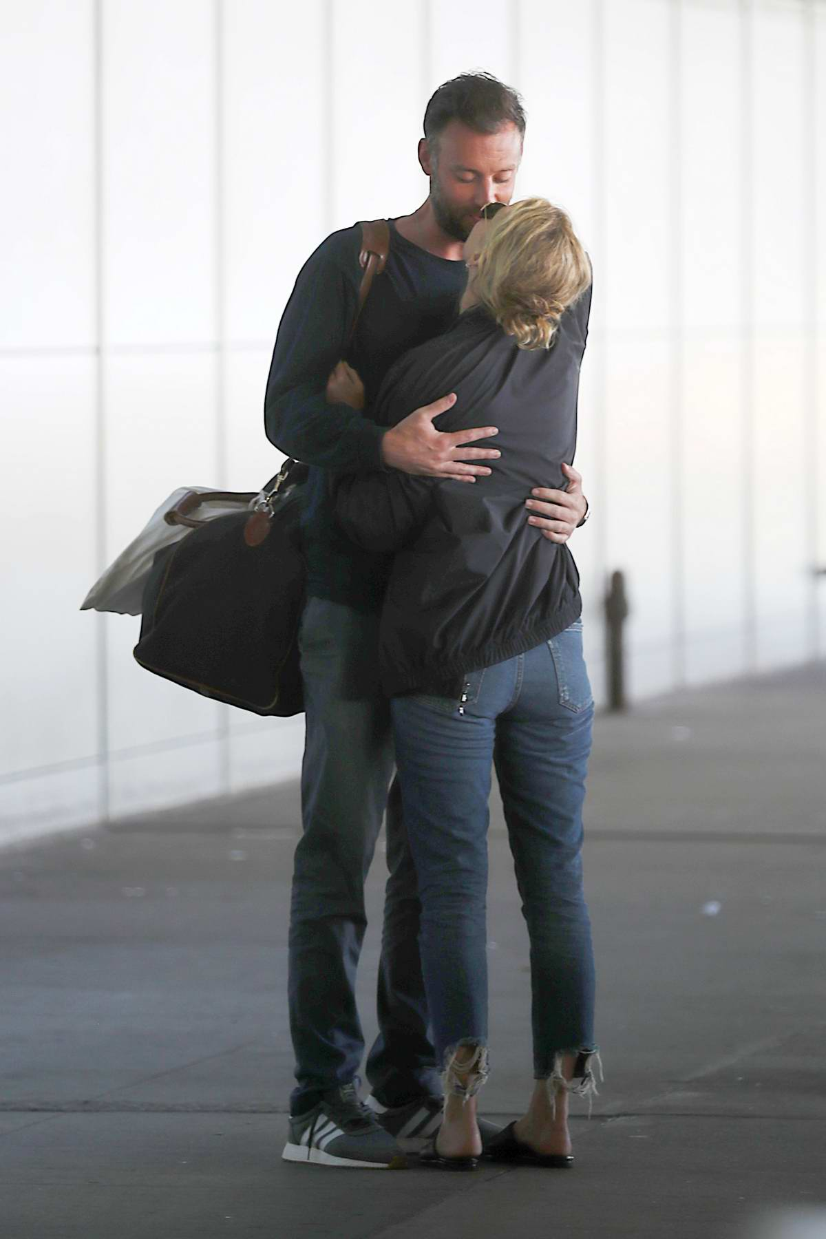 Jennifer Lawrence and Cooke Maroney share hugs and kisses after touching down at JFK airport in New York City