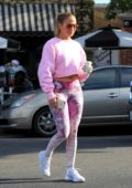 Jennifer Lopez rocks pink patterned leggings and a crop top sweater as she steps out for a fresh cup in West Hollywood, Los Angeles