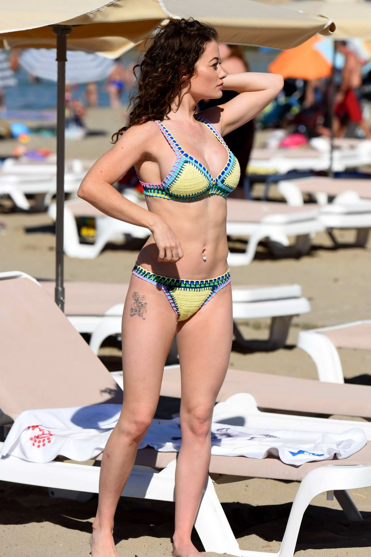 Jess Impiazzi seen in a yellow bikini while relaxing at the beach in Ibiza, Spain