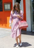 Jessica Alba wore a pink pinstripe robe dress with a custom handbag as she leaves a photoshoot in Los Angeles