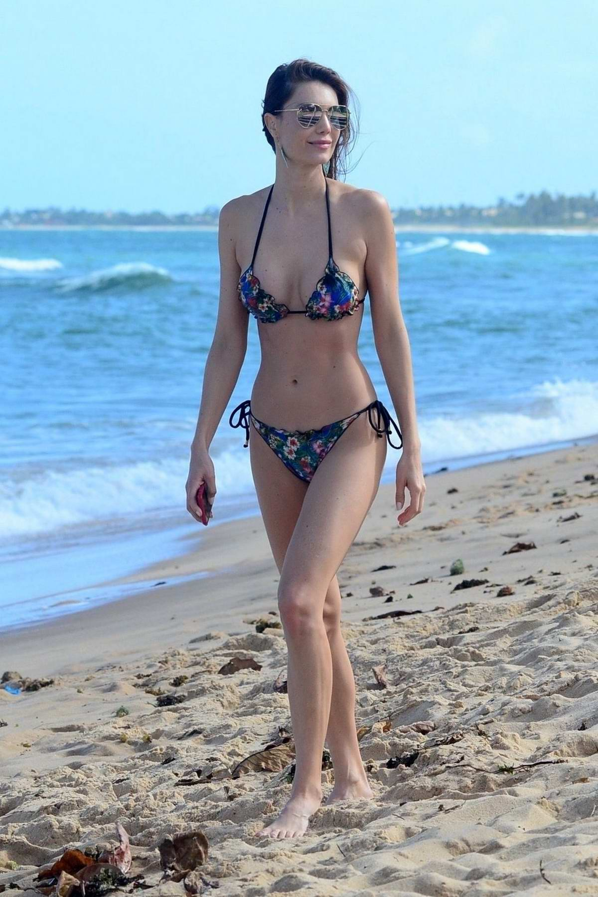 Julia Pereira hits the beach in a blue floral print bikini in Bahia, Brazil