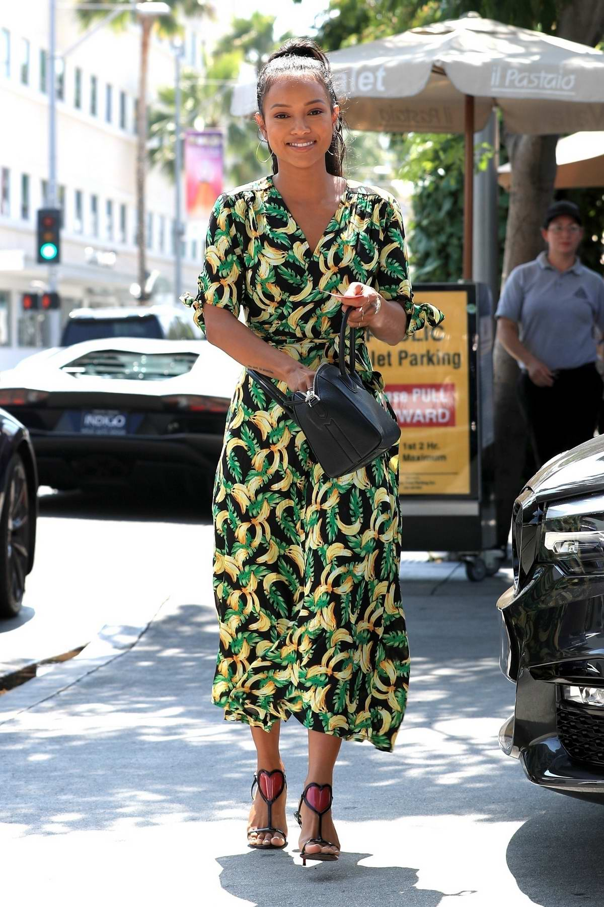 Karrueche Tran seen holding a flower bouquet as she leaves lunch at Il Pastaio in Beverly Hills, Los Angeles