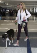 Kate Upton and her dog Harley arrives LAX airport to catch a flight out of Los Angeles
