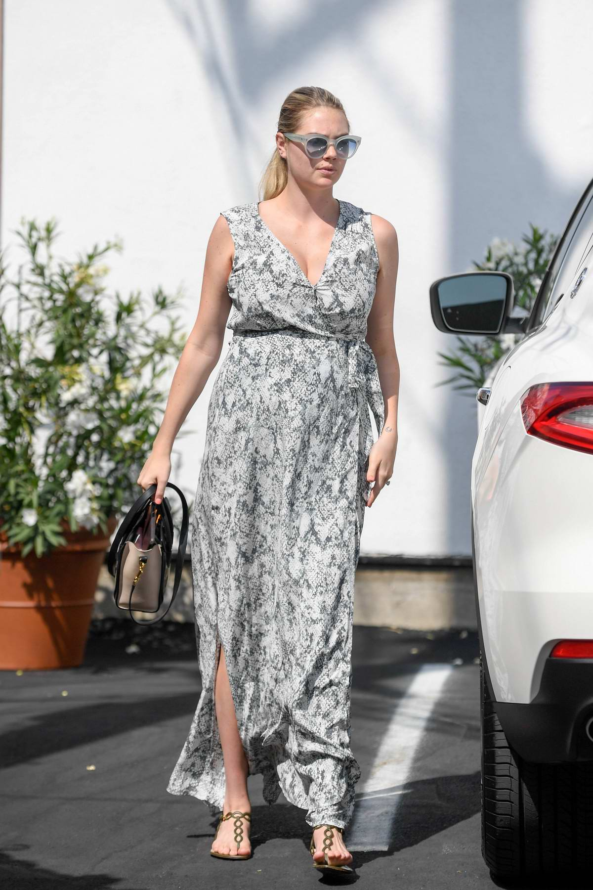 Kate Upton wears a patterned maxi dress as she stops by Carasoin Day Spa & Skin Clinic in West Hollywood, Los Angeles
