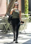 Kourtney Kardashian seen in an olive green tank top and black leggings while visiting a friend in West Hollywood, Los Angeles