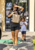 Kourtney Kardashian wears black spandex shorts with a black graphic tee as she enjoys the afternoon with her daughter in Calabasas, California