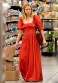 Kristen Bell wears a long red dress while shopping groceries in Los Angeles
