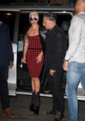 Lady Gaga wears a red and black plaid dress with high platform boots while out with Christian Carino in Paris, France