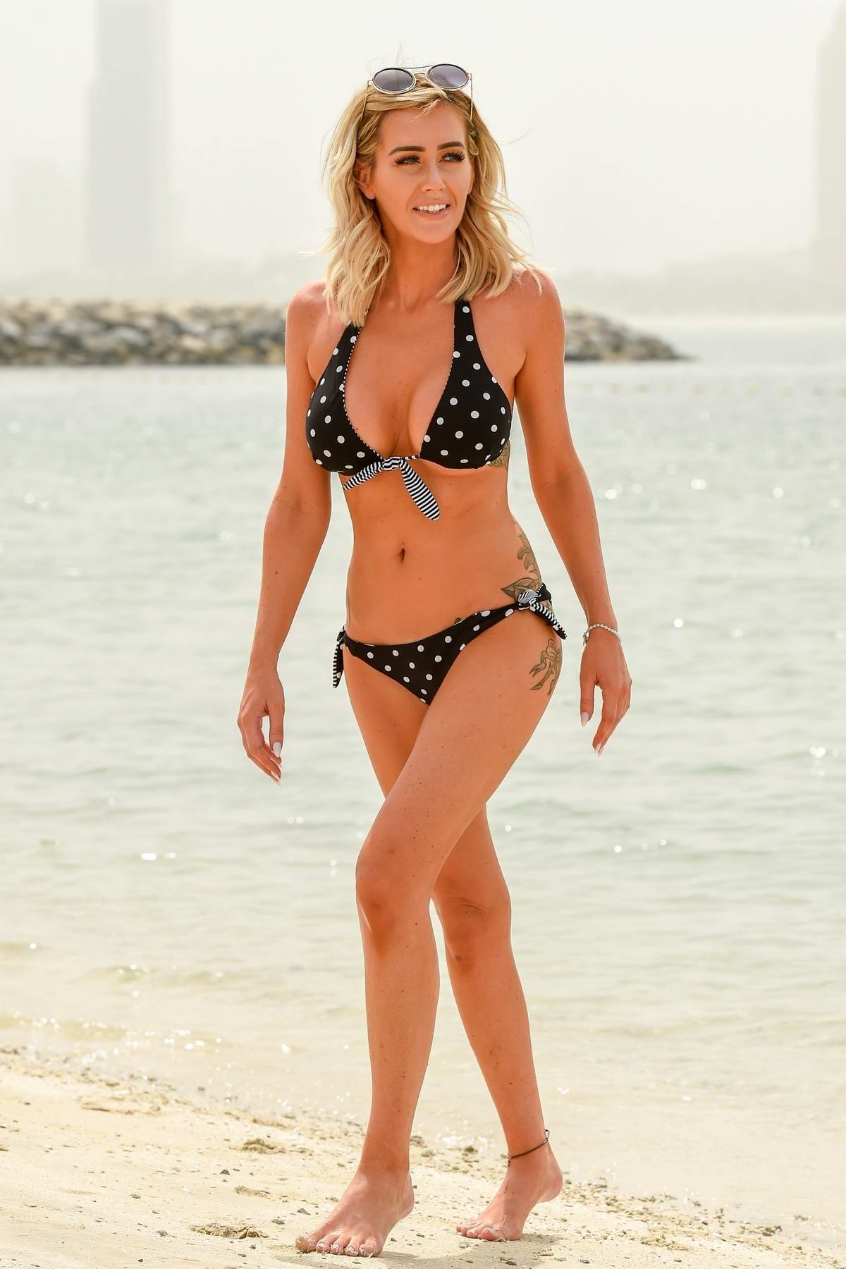Laura Anderson spotted in a black and white polka dot bikini as she cools down in the sea in Dubai