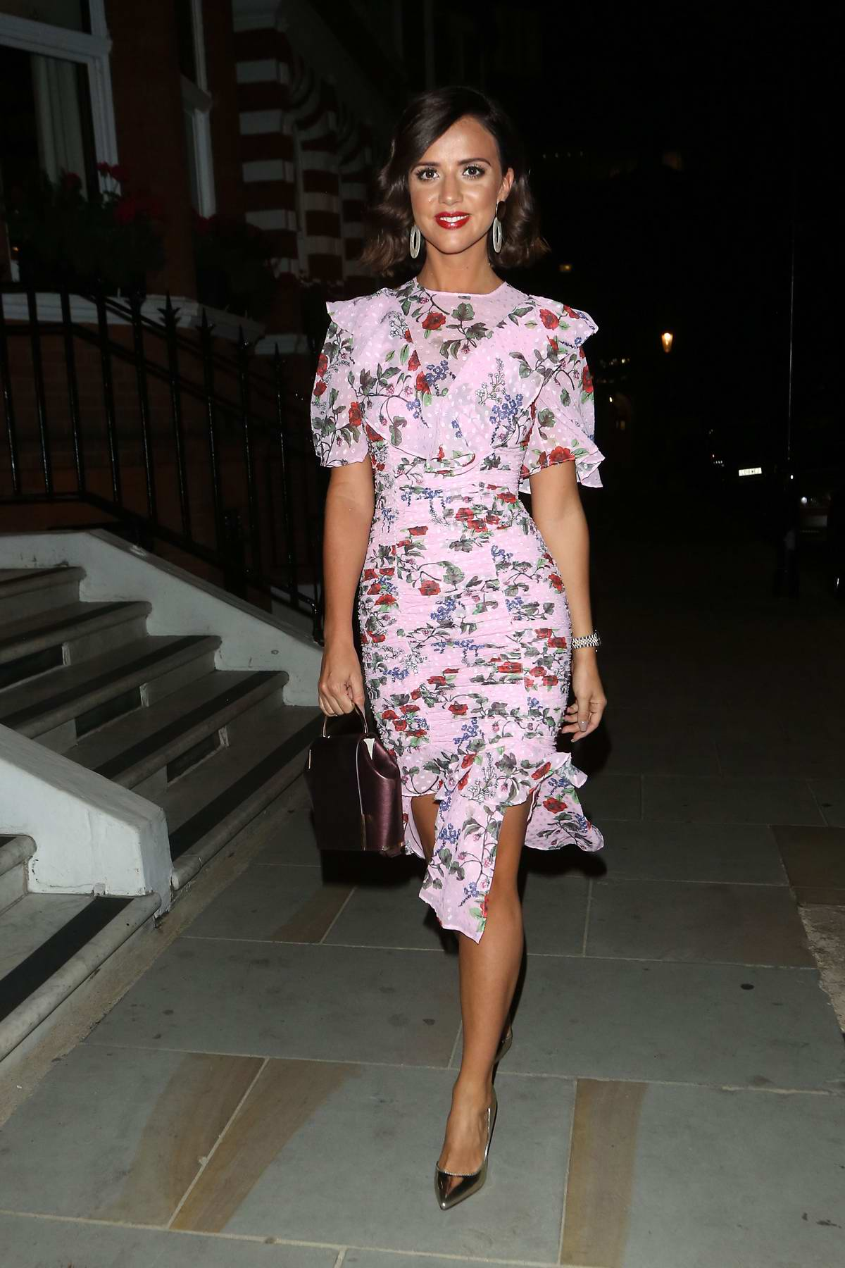 Lucy Mecklenburgh wears a floral print pink dress while out celebrating her 27th birthday in London, UK