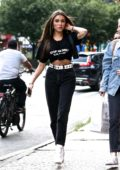 Madison Beer spotted wearing black tee and high waisted jeans with white leather boots while out in New York City