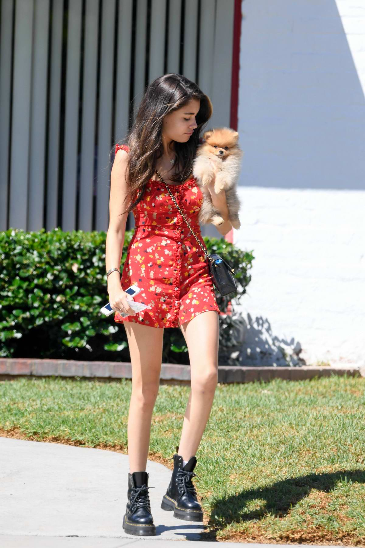 Madison Beer wears a short red dress as she takes her puppy to a vet in Beverly Hills, Los Angeles