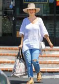 Minka Kelly is all smiles as she steps out makeup free to run some errands in Beverly Hills, Los Angeles