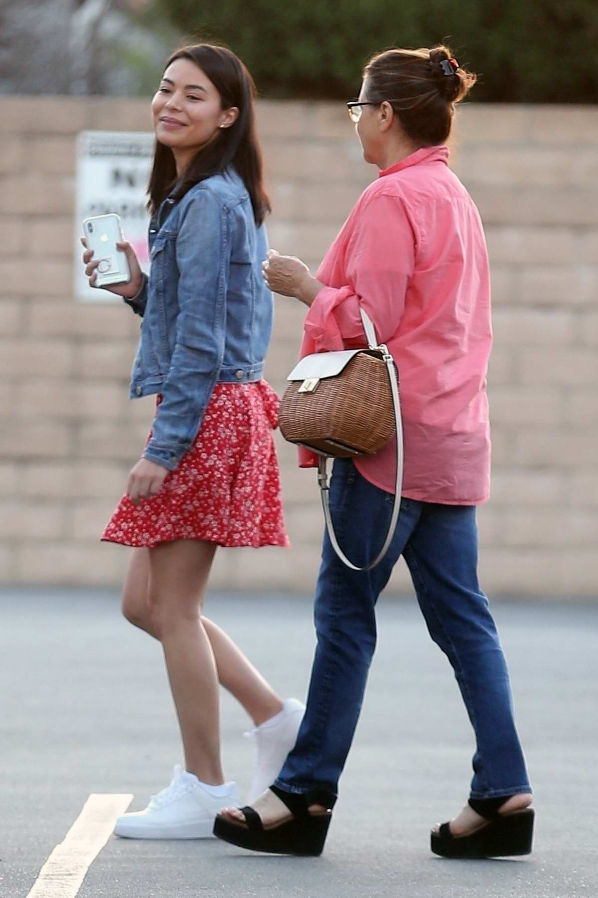 Miranda Cosgrove keeps it cute in florals as she grabs sushi with her mom in Beverly Hills, Los Angeles