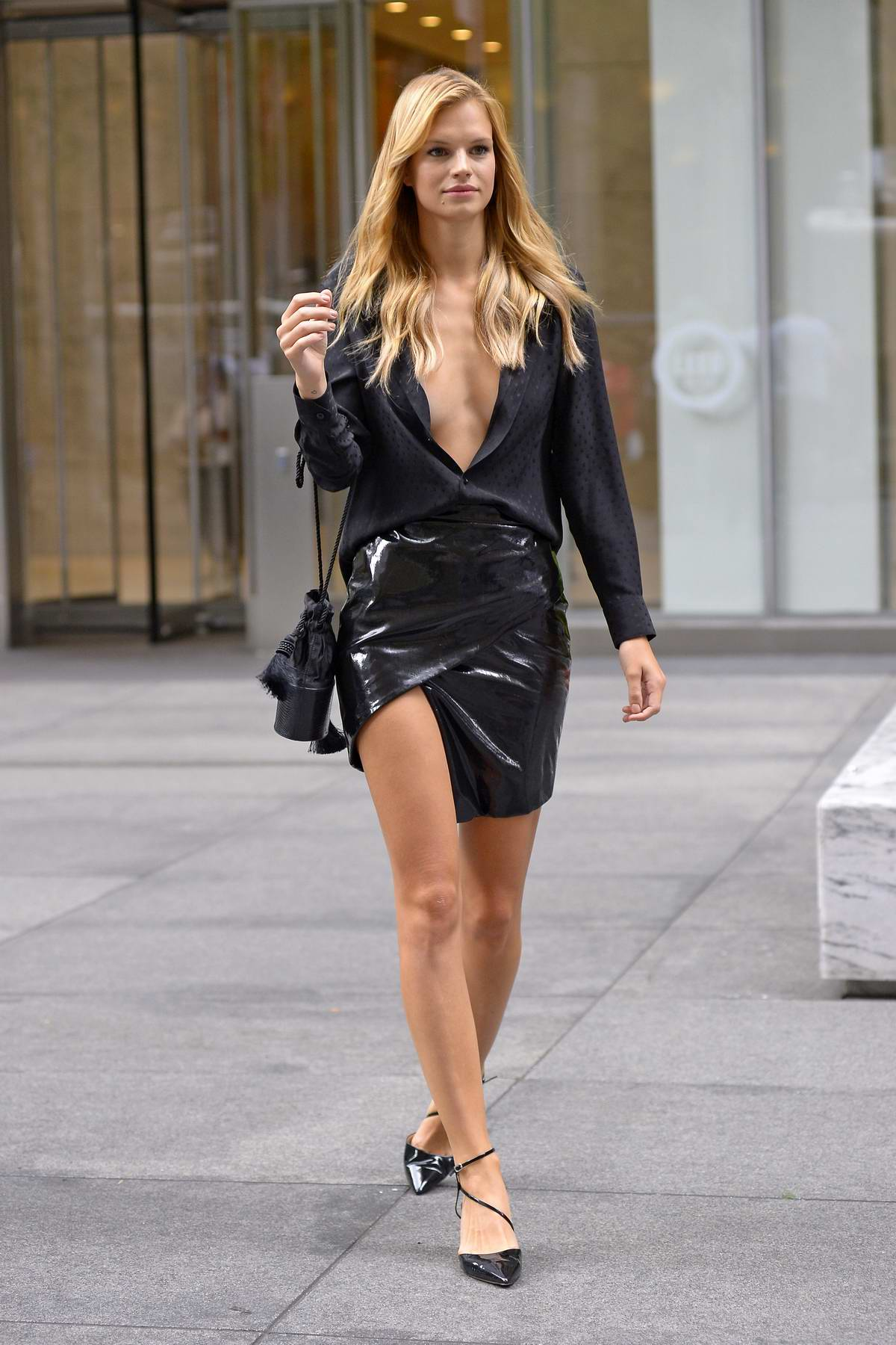 Nadine Leopold wears an unbuttoned black shirt and PVC mini skirt while promoting 'Model Squad' at SiriusXM in New York City