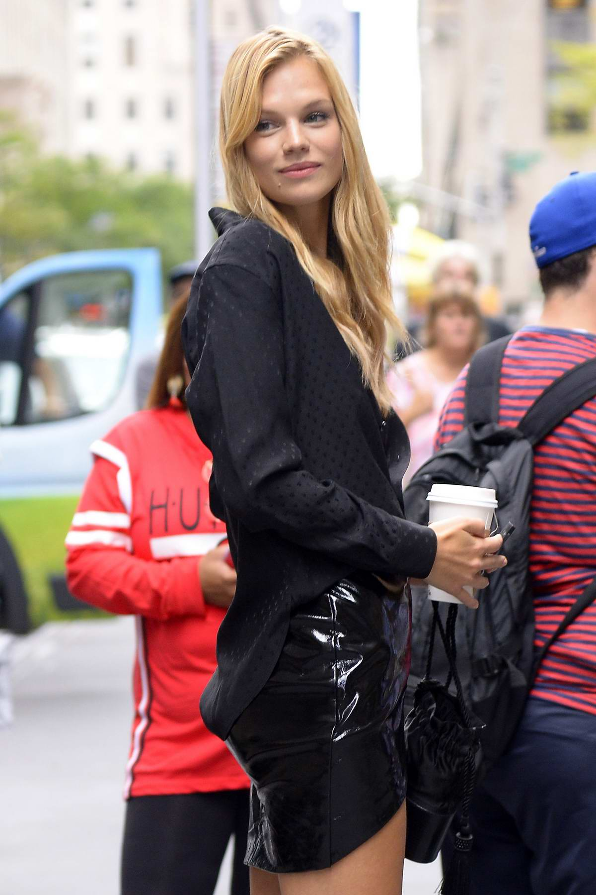 nadine leopold wears an unbuttoned black shirt and pvc ...