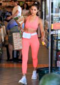 Olivia Culpo shows off her toned abs in her pink workout gear while grocery shopping at Erewhon in West Hollywood, Los Angeles