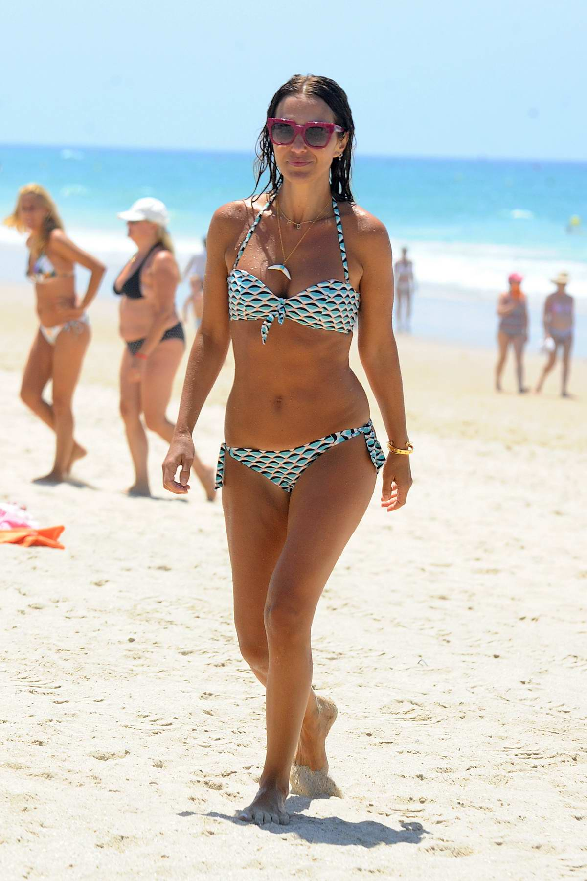 Paula Echevarria spotted in multiple bikinis at the beach in Sancti Petri, Spain