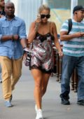 Rita Ora looked busy on her phone while out in a mini dress and sneakers in New York City