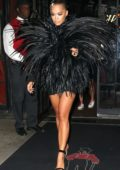 Rita Ora wears a black feather dress as she heads to the VMA's after-party in New York City