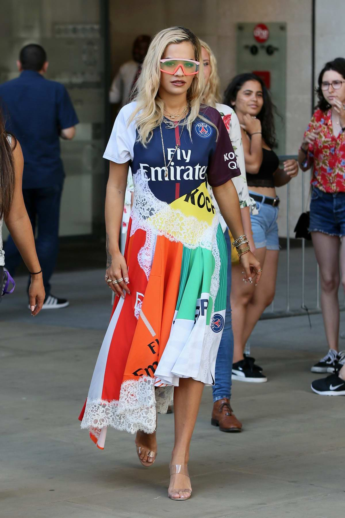 Rita Ora wears a colorful patchwork dress while visiting BBC Radio 1 in London, UK