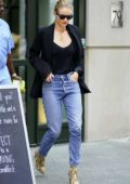 Rosie Huntington-Whiteley rocks black top with matching blazer and jeans with snakeskin boots as she heads out in New York City