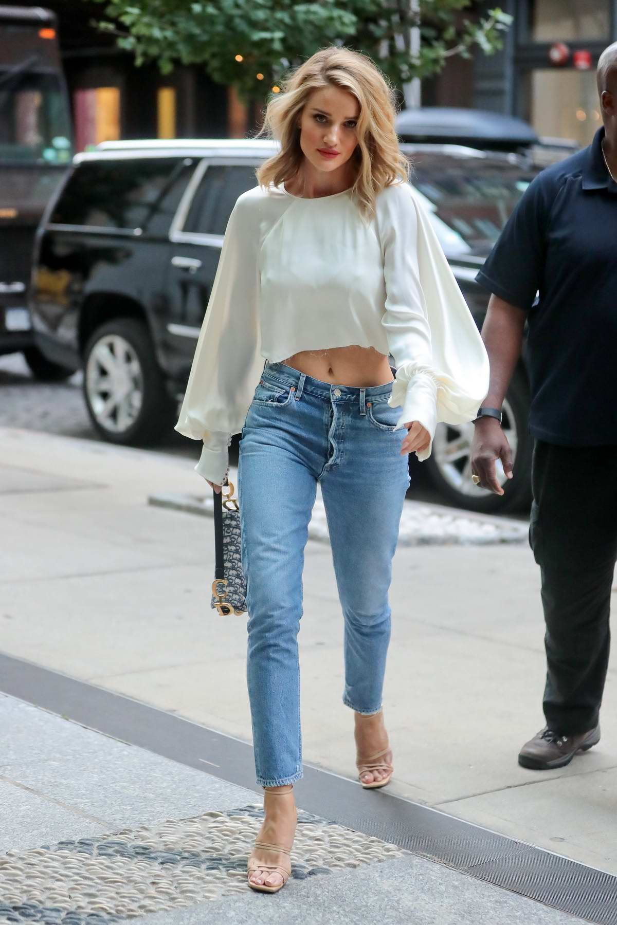 Rosie Huntington-Whiteley steps out in a white cropped top and high waist jeans in New York City