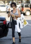 Sarah Hyland sips on some pre-workout drink as she heads in for a workout at her gym in Los Angeles