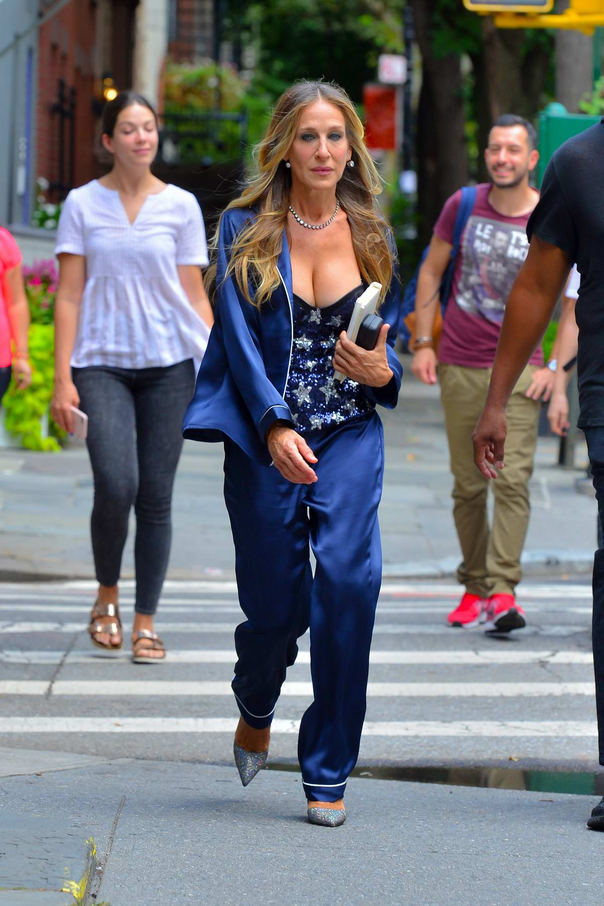 Sarah Jessica Parker spotted in blue silk pantsuit while out in New York City