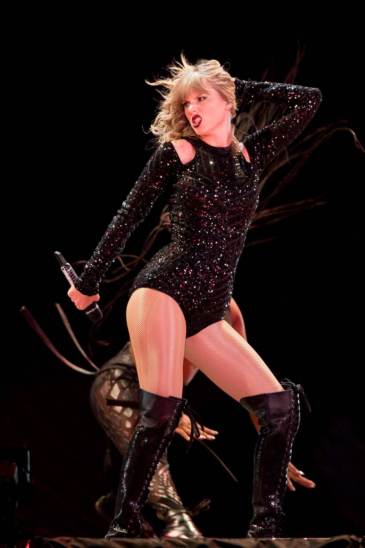 Taylor Swift performs onstage during her Reputation Stadium Tour in Nashville, Tennessee
