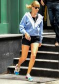 Taylor Swift rushes out her apartment in a blue jacket and black shorts as she heads to a gym in New York City