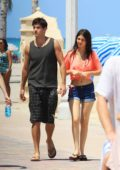 Victoria Justice and Ryan Rottman enjoys an ice cream cone while strolling around the beach in Miami, Florida