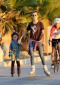 Alessandra Ambrosio enjoys rollerblading along the boardwalk with her kids in Santa Monica, California