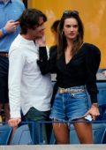 Alessandra Ambrosio kisses her new boyfriend Nicolo Oddi during the US Open finals in Queens, New York