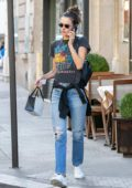 Alessandra Ambrosio wore a graphic tee and ripped jeans during a shopping trip to Mimi Luzon in Paris, France