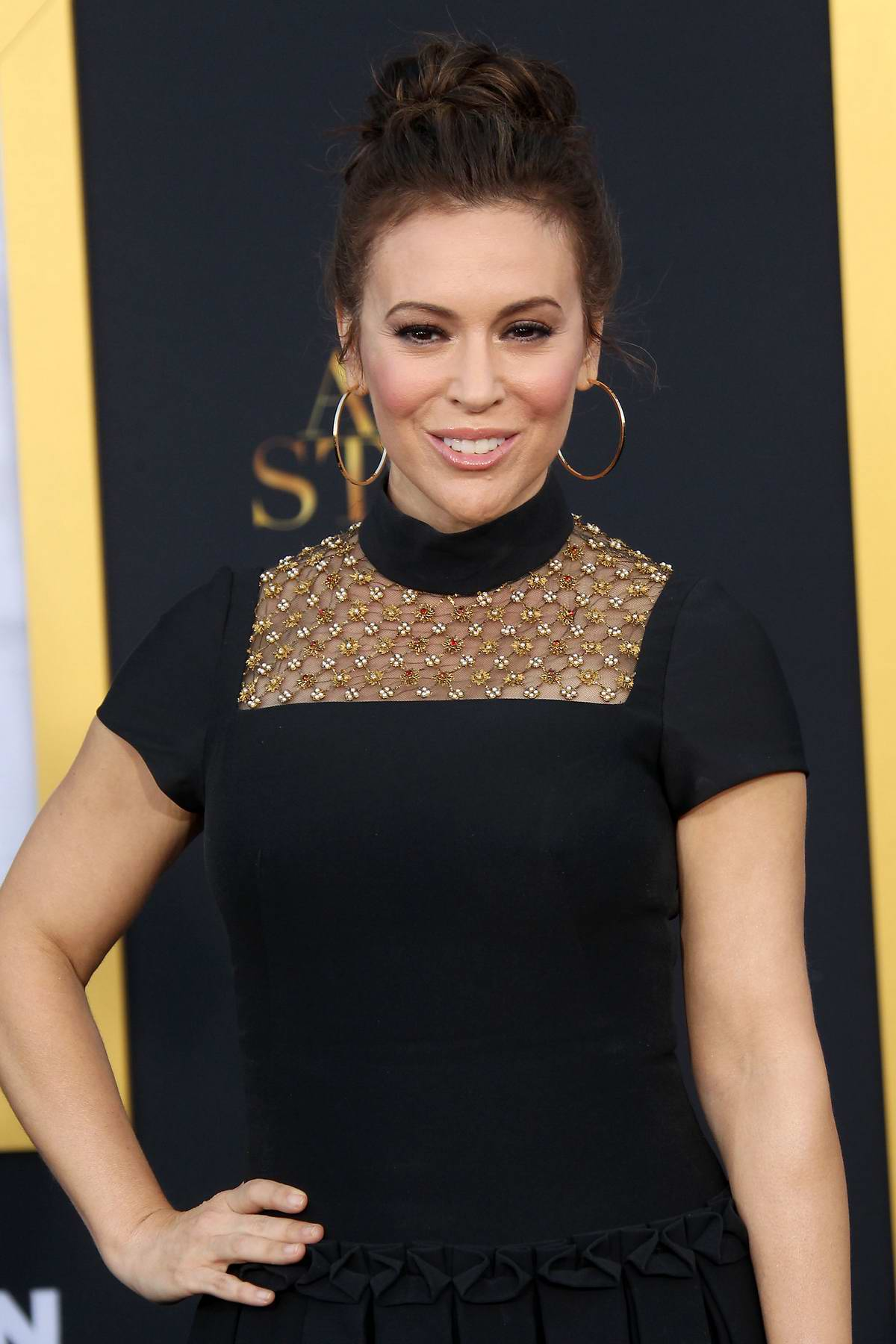 Alyssa Milano attends 'A Star Is Born' film premiere at Shrine Auditorium in Los Angeles