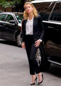 Amber Heard wearing classic black pantsuit as she arrives at 92Y in New York City