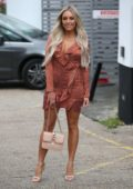 Amber Turner films a scene at La Sala restaurant in Chigwell, Essex, UK