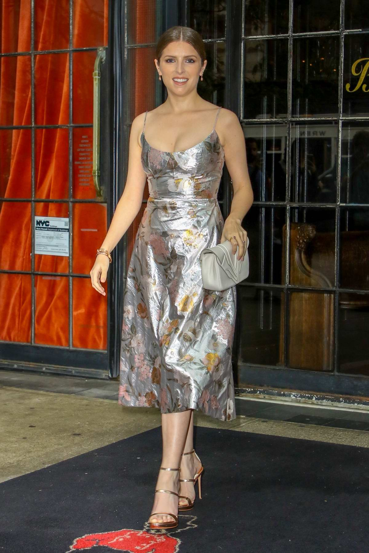 Anna Kendrick spotted in a silver dress as she leaves The Bowery Hotel and greet her fans in New York City