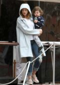 Anne Hathaway and husband Adam Shulman steps out in the rain with their son in Venice, Italy