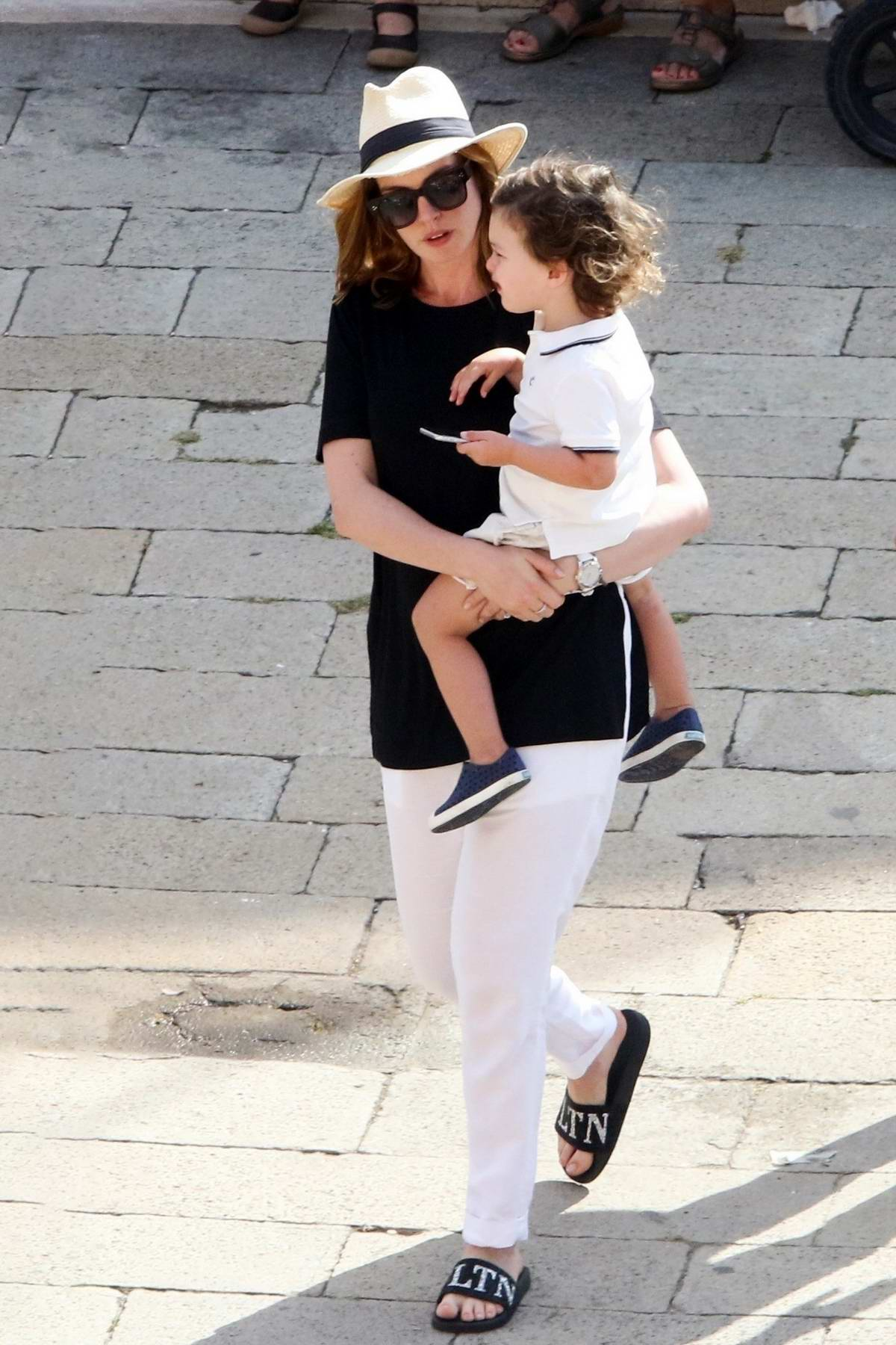 Anne Hathaway enjoys a day out with husband Adam Shulman and their son in Venice, Italy