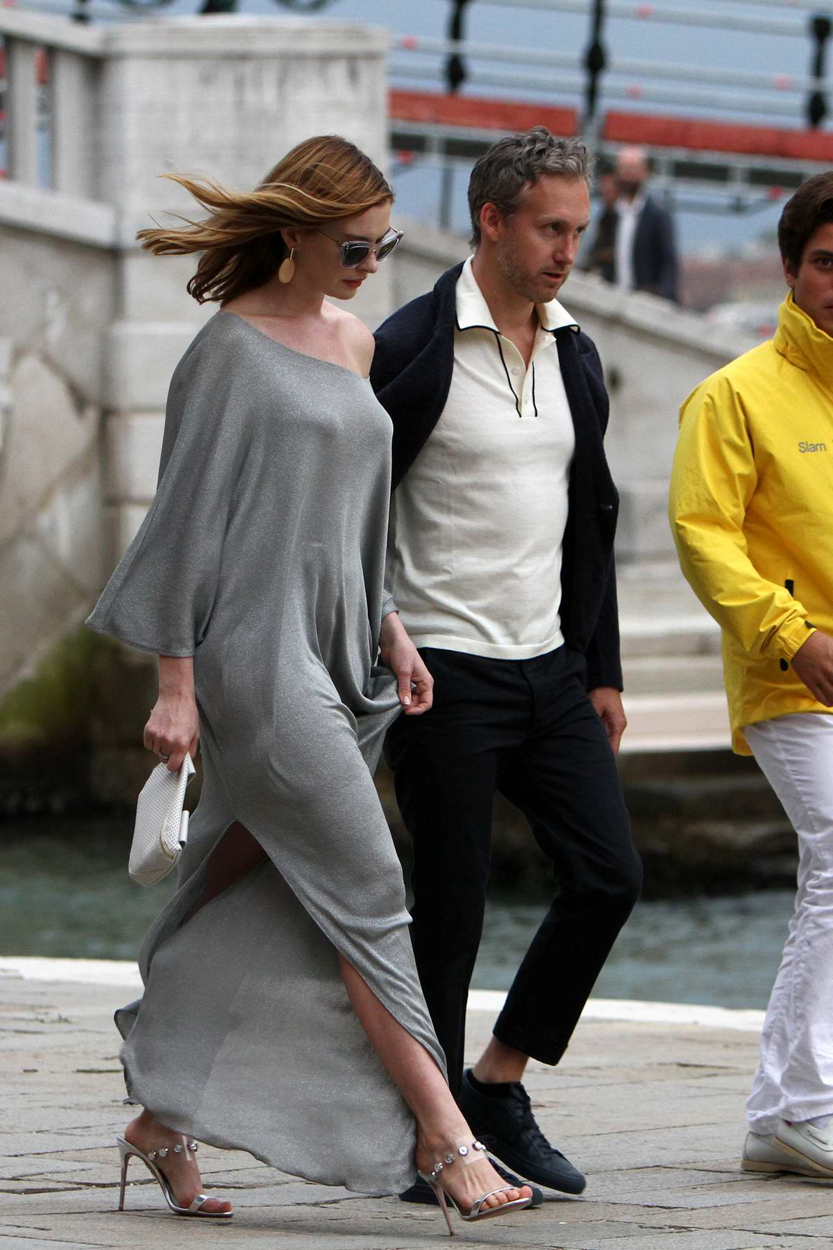 Anne Hathaway looks chic in a grey slit dress while out with husband Adam Shulman during 75th Venice Film Festival in Venice, Italy